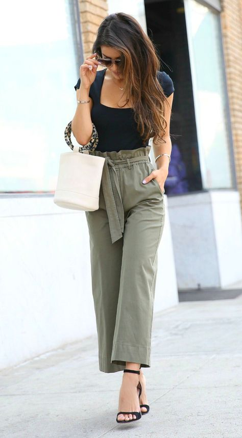 lady in cropped version of paperbag pants