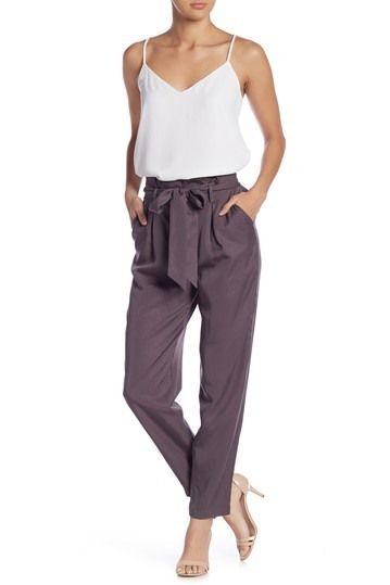 Lady wearing paperbag pants