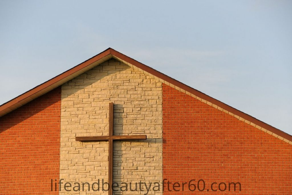 Brick church building with cross on front of building.
